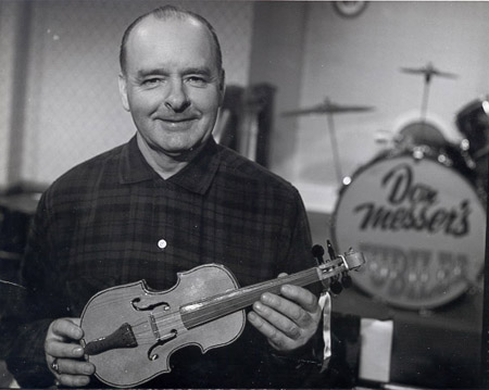 Don Messer holding a fiddle.